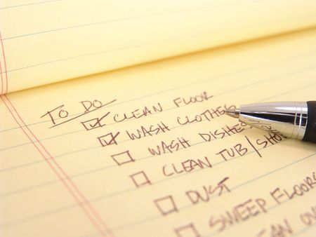 legal pad: to do list created on yellow legal pad