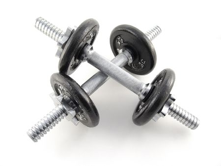 dumbbells with black weights and sliver handle isolated on white background