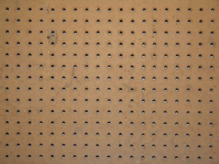 peg: peg board with holes for organizing tools in the workshop Stock Photo