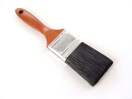 paint brush with wood handle and black bristles over white