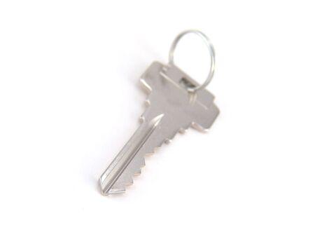single silver key isolated on white background