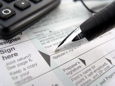 multiple tax forms with pen, calculator and glasses            Stock Photo