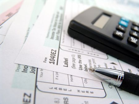 multiple tax forms with pen and calculator Stock Photo