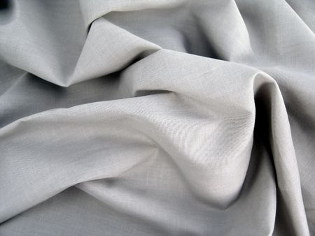 pleat: wrinkled light gray material for use as background Stock Photo