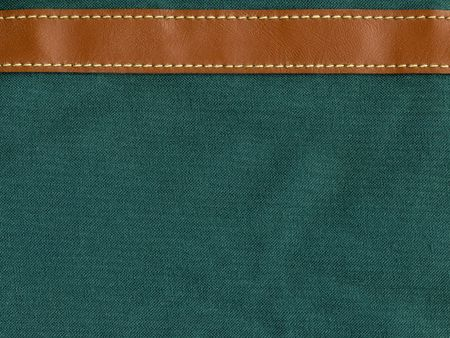 green canvas with leather strip and stitching photo