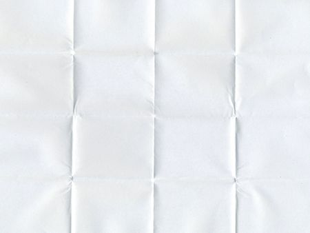 white piece of paper folded multiple times Stock Photo