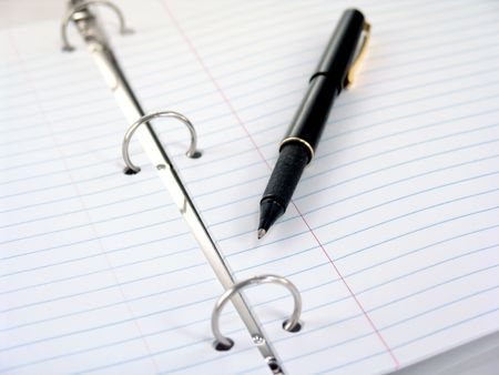 3-ring binder with lined paper and pen