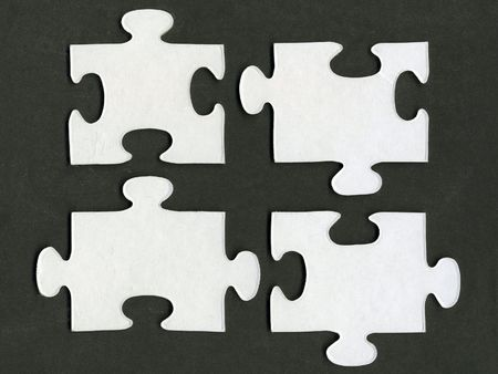 white puzzle pieces isolated over black background