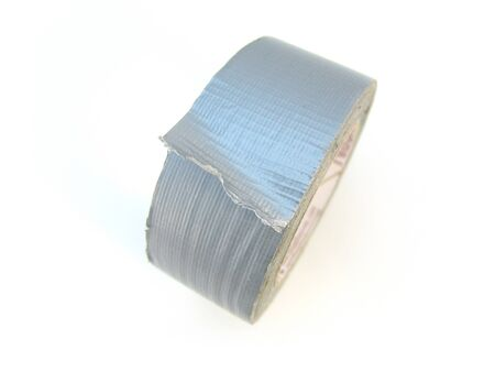tear duct: roll of silver duct tape isolated over white Stock Photo