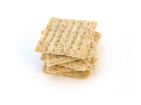 stack of whole wheat crackers isolated over white