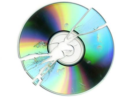 broken and cracked CD  DVD on white background
