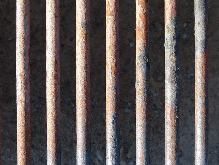 metal grate: rusty bars of metal grate on BBQ grill
