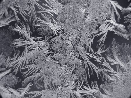 frozen water created ice crystals on surface of glass