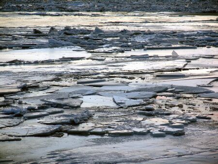 impasse: ice on surface of river, cracked and broken after thaw