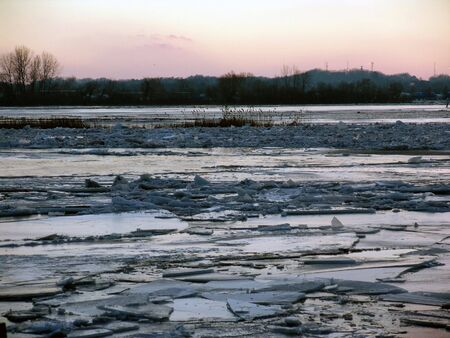 ice dam: ice on surface of river, cracked and broken after thaw
