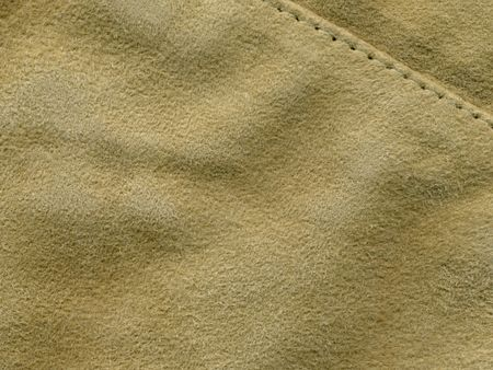 scan of light tan suede with stitching
