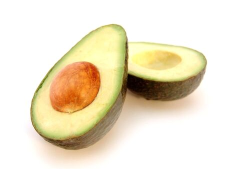avocado cut in half isolated over white background