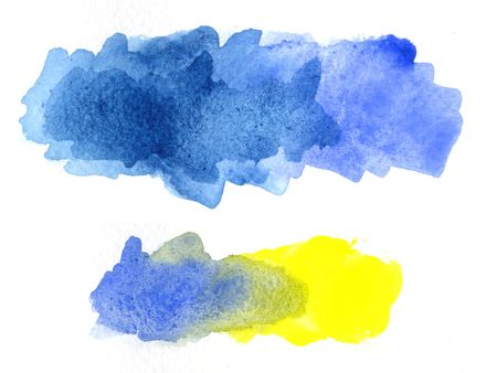 blue and yellow watercolor paint applied on white paper