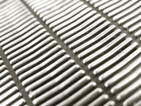 grate: close up of antique speaker grill from transistor radio