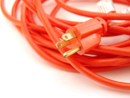 prong: orange three prong extension cord isolated over white background Stock Photo