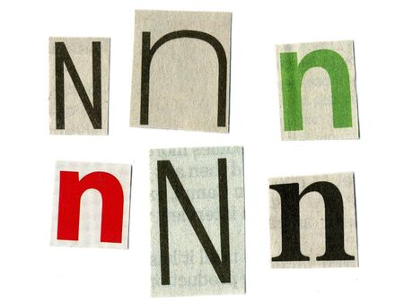 newsprint: letter n cut from newsprint paper isolated on white Stock Photo