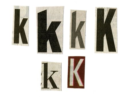 newsprint: letter k cut from newsprint paper isolated on white