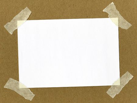 white piece of paper taped with masking tape on cardboard
