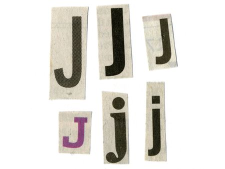 newsprint: letter j cut from newsprint paper isolated on white Stock Photo