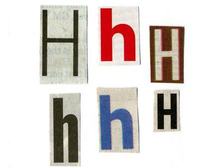 """letter """"A"""" gesneden uit krantenpapier op wit wordt geïsoleerd Stockfoto"""