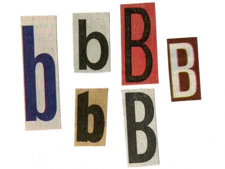 """letter """"b"""" cut from newsprint paper isolated on white"""