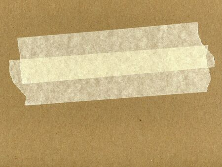cardboard with masking tape on surface