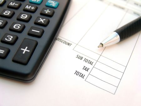 calculator with pen over printed invoice with focus on total Stock Photo