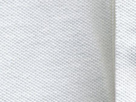 close-up of knitting of white cotton shirt