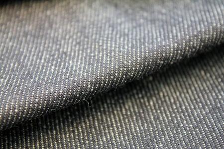 close up of folded blue denim material