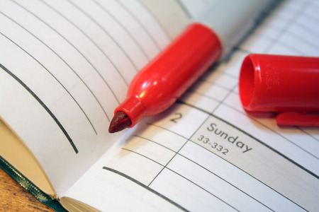 felt tip: Open calendar with red felt tip marker in spine