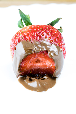 chocolate dipped strawberry with bite marks on white