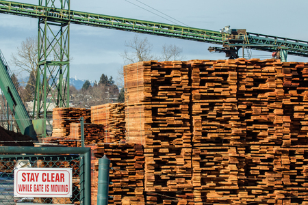 Mill producing lumber for construction and packs it for convenient shipment. Stock Photo