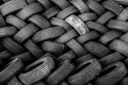 worn auto tires stacked at recycling facility Stock Photo