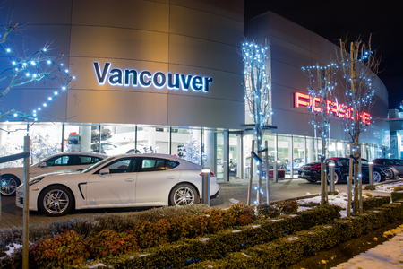Vancouver BC, Canada - January 9, 2018: Porsche is a German automobile manufacturer specializing in high-performance cars. Porsche cars in front of car dealership, luxury fast and expensive cars. Night shot is illuminated.