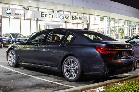 Vancouver BC, Canada - January 9, 2018: Office of official dealer BMW. BMW is a German automobile manufacturer specializing in high-performance and luxury cars. Night shot all is illuminated. Editorial