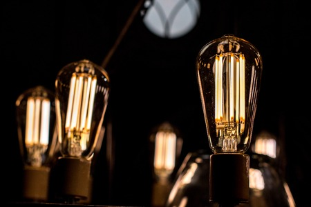 Decorative antique edison style light bulbs are in fact contamplorary LED light bulds made to look like old school. Creating old style look and saving energy Stock Photo