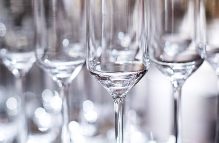 a side view of empty wine glasses on the table. Stock Photo