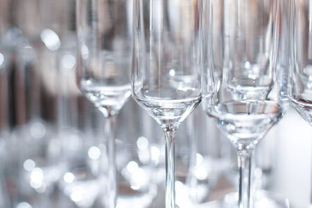 a side view of empty wine glasses on the table. Reklamní fotografie