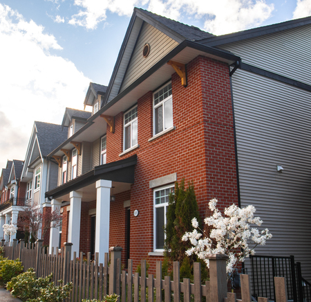 Row of Typical English Terraced Houses. Red brick homes side by side.