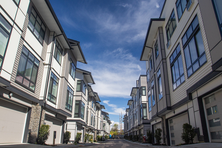 Rows of townhomes side by side. External facade of a row of colorful modern urban townhouses. brand new houses just after construction on real estate market