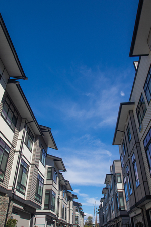 Inside of townhouse complex. townhomes are side by side. Rows of townhomes side by side. External facade of a row of colorful modern urban townhouses. brand new houses just after construction on real estate market.