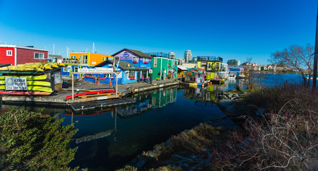 VICTORIA BC CANADA FEB 12, 2019: Victoria Inner Harbour, Fisherman Wharf is a hidden treasure area. With colorful floating homes, gifts, food and wildlife watching eco tours.