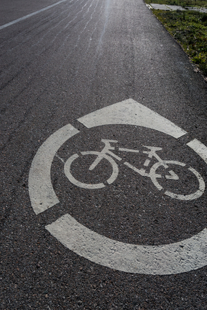 Bicycle road sign painted on the pavement. Bicycle lane,Bicycle sign on the road.