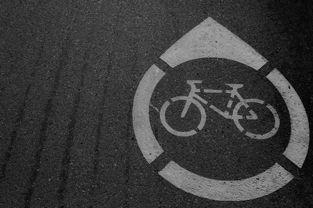 Bike path. Bicycle road sign painted on the pavement. Bicycle lane,Bicycle sign on the road
