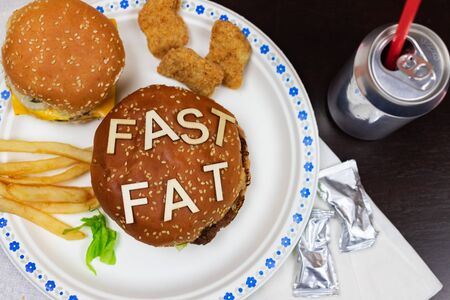 Juicy fast food burgers letters on a juicy burger. Unhealthy eating. Junk food concept. 免版税图像